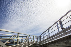 Marina footbridge over blue cloudy sky, Spain Royalty Free Stock Image