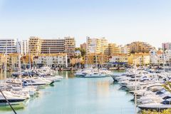 Marina full of luxurious yachts in touristic Vilamoura, Algarve,. Marina full of luxurious yachts in touristic Vilamoura, Quarteira, Algarve, Portugal royalty free stock image
