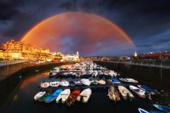 Marina of Getxo with rainbow. Marina of Getxo with stormy clouds and rainbow royalty free stock photo