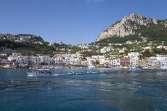 Marina Grande Harbor in the City of Capri, an Italian island off the Sorrentine Peninsula on the south side of Gulf of Naples, in  Royalty Free Stock Image