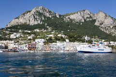 Marina Grande Harbor in the City of Capri, an Italian island off the Sorrentine Peninsula on the south side of Gulf of Naples, in  Royalty Free Stock Photo