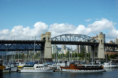 Marina, Granville Island, Vancouver, Canada. The beautiful Granville Island of Vancouver in a sunny day.  It's Granville Bridge at the back Stock Photos