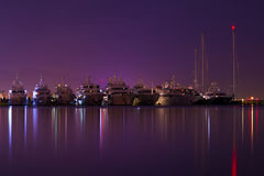 Marina in Greece. Night shot of a marina with luxury yachts in Greece Royalty Free Stock Photography