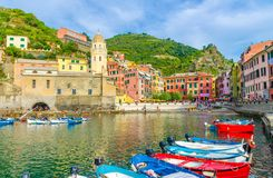 Marina harbor with boats and yachts, promenade, Chiesa di Santa Margherita church, green hill and colorful buildings houses in Ver. Nazza village, National park stock photos