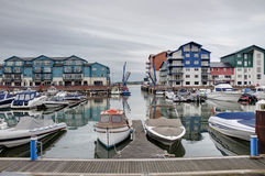 Marina houses and apartments. View of a port and modern seaside houses and apartments in Exmouth marina, Devon, England, UK royalty free stock image