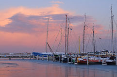 Marina and ice at sunrise, Holland Royalty Free Stock Photo