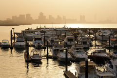 Marina with Kuwait city silhoutte Stock Photos