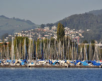 Marina on Lake Lucerne , Switzerland. A view of Lucerne from the lake with a marina seen in the foreground. Lake Lucerne offers spectacular views and a range of Royalty Free Stock Photo