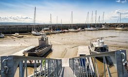 Marina at low tide. Saint Lawrence seaway boats at low tide in a harbour in Riviere du Loup Quebec, Canada Stock Photography