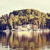Marina on Macha`s lake at sunset during sommer holidays in czech republic stock image