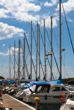 Marina masts in Vrsar. Yacht masts line up along the marina of Vrsar, Croatia stock image