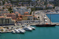 Marina in Nice. Safe place for yachts, boats, ships and various other floating means protected from the waves of the open sea. In the photo we see the port in stock photo