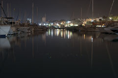 Marina at night in El Campello, Alicante, Spain. Marina at night illuminated by the lights of the city Stock Images