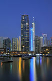 Marina Night Scene. A night time view of beautiful buildings lit up against the marina royalty free stock photography