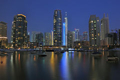 Marina Night Scene. A night time view of beautiful buildings lit up against the marina Stock Image