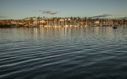 Marina in Oslo in the evening, dark waters of the fjord and the boats. Stock Photos