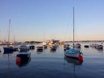 Marina på solnedgången Arkivbild