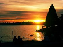 Marina Park at Sunset. A lakeside sunset with people in silhouette royalty free stock photos
