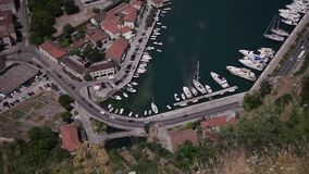 Stock Video Footage 1920x1080 Marina parking. We look down on boats parking, climb higher, and here at the same yachts and cars look like toys stock video footage