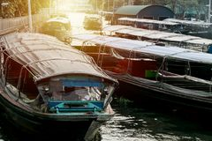 Marina Passenger boat,Thai lifestyle. Between the old wooden house of people and the temple to living along the San-Sab canal : Bangkok ,Thailand Stock Photos
