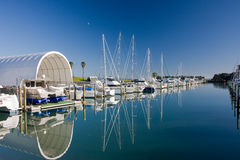Marina on a peaceful day. Yachts and boats rest in Pine Harbor Marina, Auckland, New Zealand stock photography