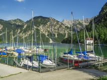 Marina at the Plansee with blue sky Stock Photo