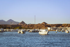 Marina: Pleasure sightseeing boats on the Parking lot of boat Stock Photography