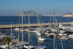 The marina port of Moraira. View of yachts and sailing boats in the marina port of Moraira, Calpe and Peñon de ifach in the background, Costa Blanca, Alicante Royalty Free Stock Photos
