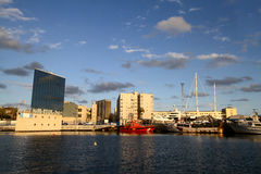 Marina Port Vell in Barcelona. With utility ships and authority buildings Stock Images
