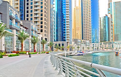 Marina Promenade. The promenade of a marina with luxury apartments at the waterfront Stock Image