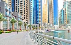 Marina Promenade. The promenade of a marina with luxury apartments at the waterfront stock image
