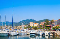 Marina of Propriano, South Corsica, France. Pleasure motor boats and sailing yachts are moored in marina of Propriano, South Corsica, France Stock Photos