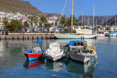 Marina in Puerto de Mogan 02, Gran Canaria, Spain. Colorful fishing boats moored in the small marina of Puerto de Mogan on the south coast of Gran Canaria Island Royalty Free Stock Photos