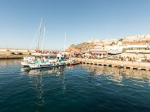 Puerto Rico, Gran Canaria - December 12 2017: Marina of Puerto Rico, tourists going on boat trips in the morning. Many. Marina of Puerto Rico, tourists going on Royalty Free Stock Image
