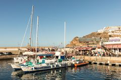 Puerto Rico, Gran Canaria - December 12 2017: Marina of Puerto Rico, tourists going on boat trips in the morning. Many. Marina of Puerto Rico, tourists going on Royalty Free Stock Images
