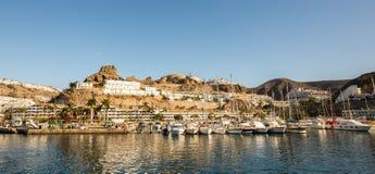 Puerto Rico, Gran Canaria - December 12 2017: Marina of Puerto Rico, a very popular travel destination. Sailboats in the Stock Image