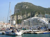 Marina Quay, Gibraltar, with yachts and the floating Gibraltar Casino. Marina Quay, Gibraltar, with moored yachts large and small, Gibraltar`s huge, floating stock image