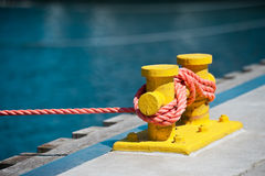 In the marina. The quay. A mooring line attached to a bitt Stock Photography