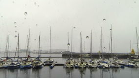 Marina in rain stock video footage