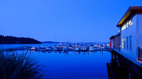 A marina and restaurant. During magical blue hour, Vancouver Island, Canada Stock Photography