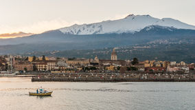 The marina of Riposto during the sunset; volcano Etna in the background Royalty Free Stock Photo