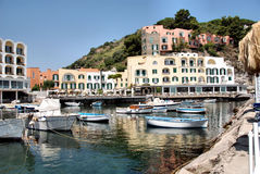 Marina with rowing boats. A frame homes, a small village of fishermen and to a hotel ischia Stock Photography