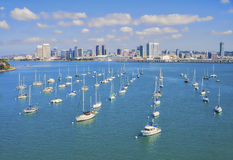 Marina and San Diego Skyline, California. Small sail boats in a marina located in the city of Coronado, provide a foreground to the skyline panoramic vista of Stock Photography