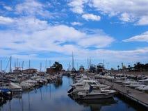 Marina Sant Carles de la Rapita Catalonia. Boats in the harbor and sky full of clouds Stock Photo