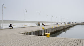 Marina on Sopot Pier. SOPOT, POLAND. APRIL 4TH 2017. Visitors and locals enjoy the peace beside the small marina at the end of Sopot`s famous pier Royalty Free Stock Photos