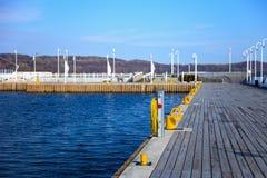 Marina in Sopot. Yellow mooring bollard on wooden marina in Sopot, Poland royalty free stock image