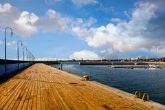 Marina in Sopot. Yellow mooring bollard on wooden marina in Sopot, Poland stock photos