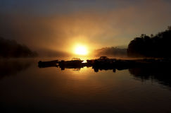 Marina Sunrise. A shot of a marina dock and boats in silhouette against the summer morning sunrise on a lake in Canada Stock Image