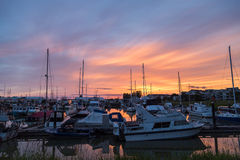 Marina At Sunset. Fishing Boats And Pleasure Crafts Docked At A Marina royalty free stock photo