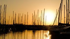 Marina Sunset. Sun setting behind an oceanfront marina at Herzliya, Israel Royalty Free Stock Photography
